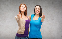 Two smiling girls showing thumbs up Royalty Free Stock Image