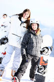 Two smiling girls with snowboards Royalty Free Stock Photography