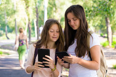 Two smiling girls with the tablets Stock Image