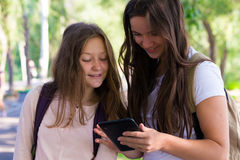 Two smiling girls with the tablets Stock Photos