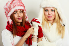 Two smiling girls in warm winter clothing. Stock Image