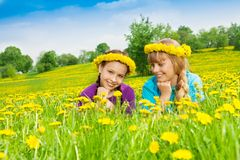 Two smiling girls wearing flower wreath Royalty Free Stock Images