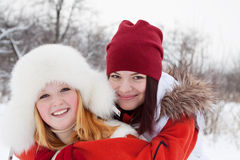 Two smiling girls in winter Stock Photos