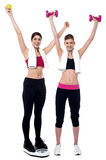 Two smiling girls working out together Stock Images