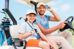 Two smiling golfers. Stock Photography