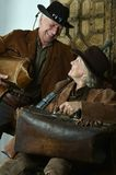 Two smiling hunter in western clothes Royalty Free Stock Photos