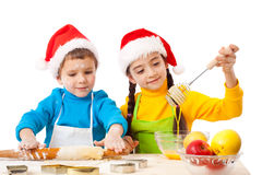 Two smiling kids with Christmas cooking Royalty Free Stock Photography