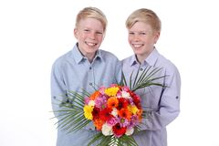 Two smiling kids with flowers isolated Royalty Free Stock Photos