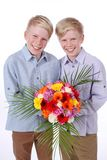 Two smiling kids with flowers isolated Royalty Free Stock Photo