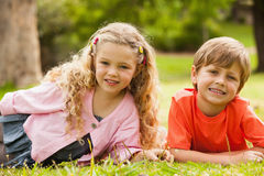 Two smiling kids lying at park Royalty Free Stock Photo