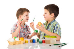Two smiling kids painting easter eggs Stock Image