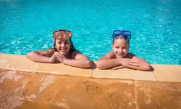 Two smiling kids relaxing on swimming pool Royalty Free Stock Photo