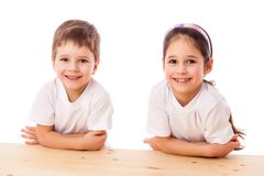 Two smiling kids at the desk stock photo