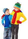Two smiling kids in winter clothes. Standing together, isolated on white Stock Photos