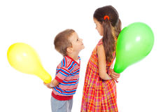 Two smiling little children with color balloons Stock Photos