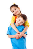 Two smiling little children standing together Royalty Free Stock Images