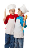Little cooks with ladle and rolling pin Royalty Free Stock Photography