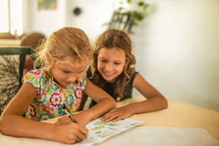 Two smiling little sisters draw Stock Photos