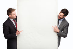 Two smiling man after panel Royalty Free Stock Images
