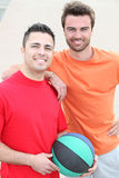 Two smiling men with basket ball Royalty Free Stock Photo