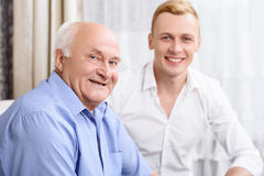 Two smiling men of different ages Stock Photography