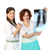 Two smiling nurses with X-ray Stock Photos