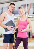 Two smiling people with clipboard and measure tape Stock Photo