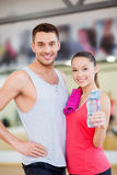 Two smiling people in the gym after class Stock Photo