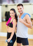 Two smiling people in the gym Stock Images