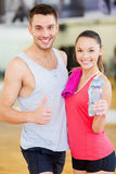 Two smiling people in the gym Royalty Free Stock Photography