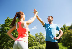 Two smiling people making high five outdoors Royalty Free Stock Photo