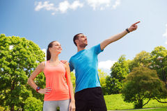 Two smiling people outdoors Stock Image