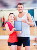 Two smiling people showing blank tablet pc screen Stock Photo