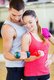Two smiling people working out with dumbbells Stock Image