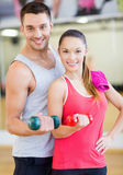 Two smiling people working out with dumbbells Royalty Free Stock Images