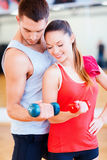 Two smiling people working out with dumbbells Royalty Free Stock Image