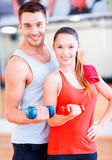 Two smiling people working out with dumbbells Royalty Free Stock Photography