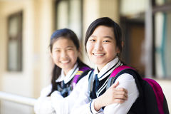Two smiling pretty student girls. In school Royalty Free Stock Photos
