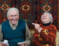 Two smiling senior. Eating dessert Stock Photo