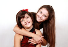 Two smiling sisters, on white Stock Photo