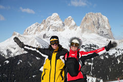Two smiling skiers in mountains Stock Photo