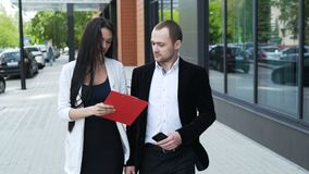 Two business partners discuss strategy for success stock video footage