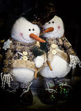 Two smiling snowman. Christmas decoration two smiling snowman wearing cute jackets with buttons and tied scarves Stock Photos