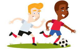 Two smiling soccer players chasing after football Royalty Free Stock Photos