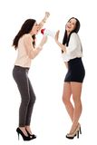 Two smiling standing women crying in megaphone Stock Photo