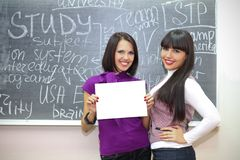 Two smiling students Stock Photography