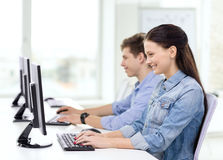 Two smiling students in computer class Royalty Free Stock Photos