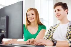 Two smiling students having discussion Royalty Free Stock Photo