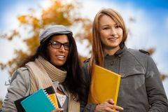 Two smiling students in park Royalty Free Stock Images
