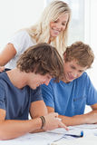 Two smiling students studying together Royalty Free Stock Photo